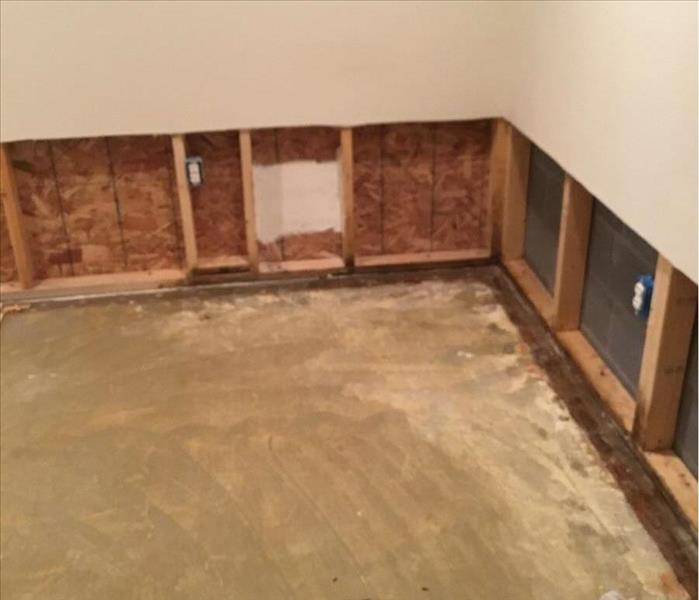 clean floor hallway with holes in walls after water damage