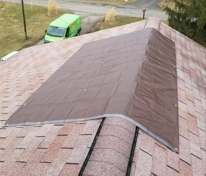 Roof Tarping Prevents Leaks After