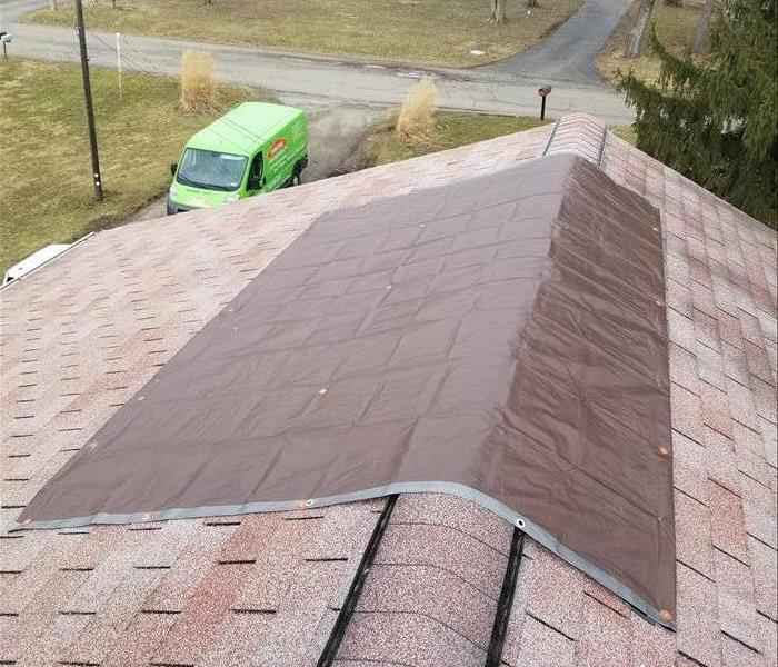 Storm Damage Roof Tarping = Good Quick Fix